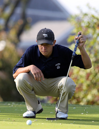 Salem: Peabody junior Matt Correale lines up a putt on the 9th green during the NEC Golf Open on Thursday afternoon at Tedesco Country Club. David Le/Salem News