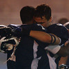 Braintree: North Shore Tech senior captain Dan Bailey (33) gets a hug from junior captain Yordany Sanchez (7) after the Bulldogs fell 23-22 to Blue Hills Regional Tech in the Massachusetts Vocational Small School Division Championship on Thursday evening. DAVID LE/Staff Photo