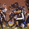 Braintree: North Shore Tech junior quarterback Yordany Sanchez (7) tries to leap through the offensive line against Blue Hills on Thursday evening. DAVID LE/Staff Photo