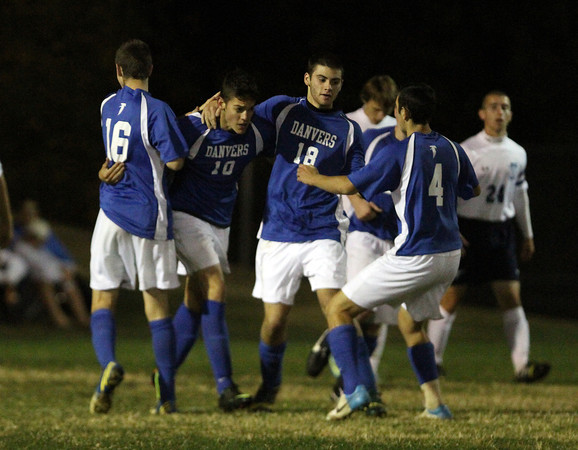 Peabody: Danvers senior Caio Silva (10) gets mobbed by his teammates after scoring the game-tying-goal on a corner kick on Wednesday evening. David Le/Salem News