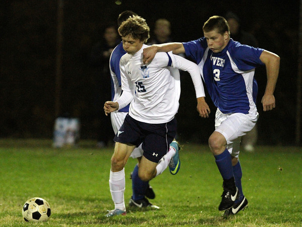 Peabody: Peabody captain Benjamin Britton (15) shields Danvers senior Mark McCarhty (23) from the ball as they sprint upfield on Wednesday evening. David Le/Salem News