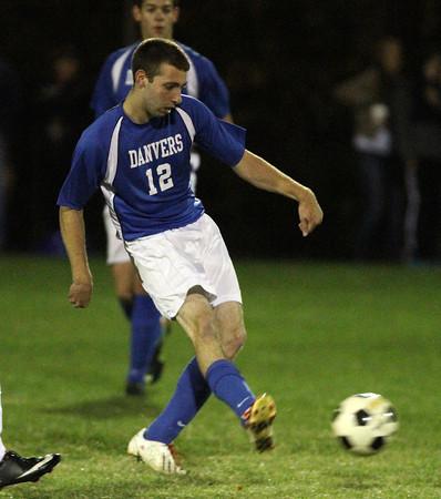 Peabody: Danvers senior midfielder Ryan Kelleher (12) passes upfield against Peabody. David Le/Salem News