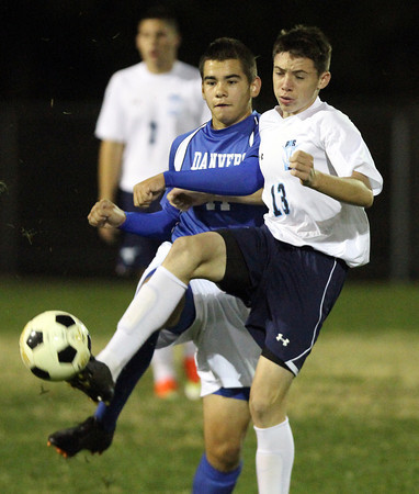 Peabody: Peabody midfielder Kenny Sawyer (13) controls the ball against Danvers forward Nikolay Sakhin (11) on Wednesday evening. David Le/Salem News
