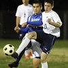 Peabody: Peabody midfielder Kenny Sawyer (13) controls the ball against Danvers forward Nikolay Sakhin (11) on Wednesday evening. David Le/Salem News