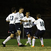 Peabody: Peabody's Vinicius Dos Santos (10) gets high fives from his teammates after scoring the first goal of the game against Danvers on Wednesday evening. David Le/Salem News