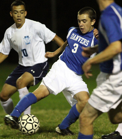 Peabody: Danvers senior midfielder Mike Powers (3) controls the ball against Peabody on Wednesday evening. David Le/Salem News