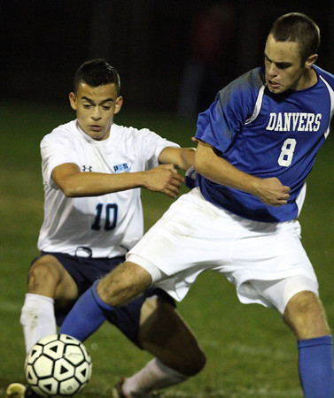 Peabody: Danvers senior captain Zach Noring (8) and Peabody's Vinicius Dos Santos (10) battle for the ball. The Falcons and Tanners battled to a 1-1 tie on Wednesday evening. David Le/Salem News