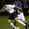 Peabody: Peabody midfielder Kenny Sawyer (13) tries to shield the ball from Danvers forward Mark McCarthy (23) on Wednesday evening. David Le/Salem News