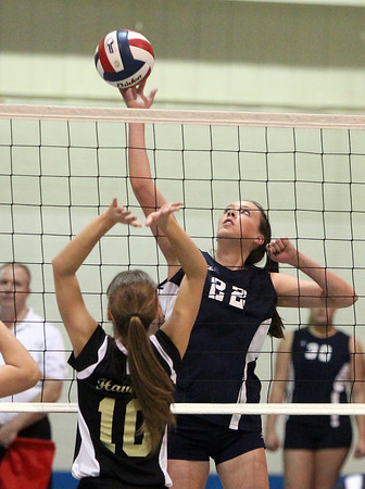Peabody: Peabody junior Emily Diezemann (22) leaps high in the air and spikes the ball past Haverhill junior Ornela Llupo (10) on Wednesday evening. David Le/Salem News