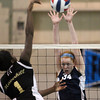 Peabody: Peabody senior captain Carolyn Scacchi (34) extends her arms high in the air to try and block a shot from Haverhill junior Abigail Sonuga (1) on Wednesday evening. David Le/Salem News