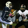 Peabody: Peabody senior Andrew McLaughlin (17) hauls in a touchdown pass from quarterback Mike Raymond ahead of Salem senior captain Austin Connolly (25) on Friday evening. David Le/Salem News