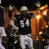 Peabody: Peabody senior captain Joseph Molica (54) screams in celebration while giving a touchdown signal after senior running back Cody Wlasuk scored his third rushing touchdown of the first half on Friday evening. David Le/Salem News