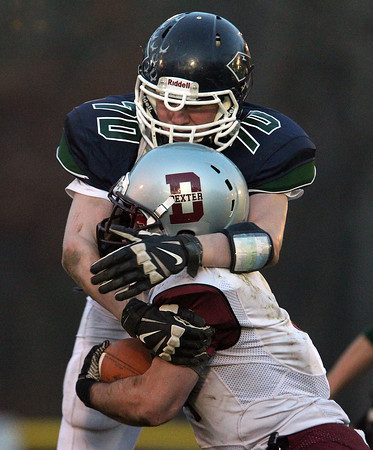 Hamilton: Pingree sophomore John VanTuyl takes down Dexter Southfield quarterback Luke Cuneo. David Le/Salem News