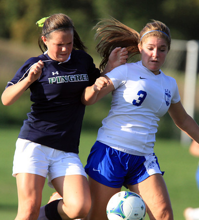 Hamilton: Pingree sophomore Charlotte Esty battles with an LCA player for the ball on Wednesday afternoon. David Le/Salem News