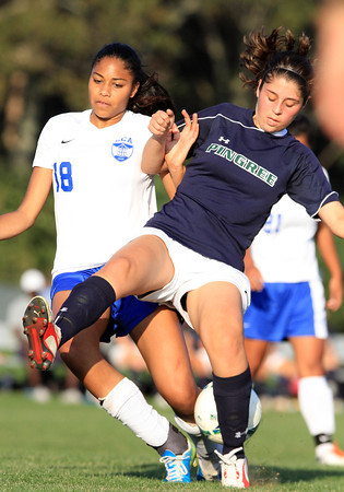 Hamilton: Pingree midfielder Nicole Scarfo, right, collides with an LCA player during a battle for the ball on Wednesday afternoon. David Le/Salem News