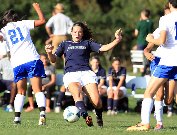 Hamilton: Pingree senior captain Kristina Caradonna, center, plays the ball upfield past an LCA player on Wednesday afternoon. David Le/Salem News