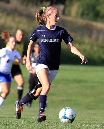 Hamilton: Pingree senior midfielder Kasey Provost carries the ball upfield against LCA on Wednesday afternoon. David Le/Salem News