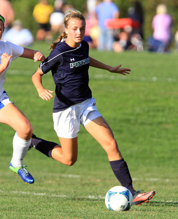 Hamilton: Pingree freshman Megan Foye races down field carrying the ball against LCA on Wednesday. David Le/Salem News
