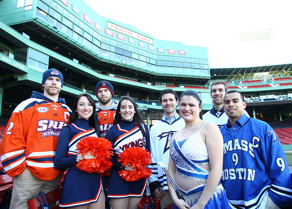 Boston: The captains from the UMass Boston and Salem State University Ice Hockey and Cheerleading squads came together at Fenway Park on Tuesday afternoon for a ceremonial coin flip to determine the home and away teams for their Frozen Fenway matchup January 7, 2014. David Le/Salem News