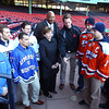 Boston: From left, UMass Boston Head Coach Peter Belisle, UMass Boston hockey tri-captains Cam Harvey, Travis Daniel, and Mark Grinhaus, Salem State University President Patricia Maguire-Meservey, UMass Boston Chancellor Keith Motley, Salem State University hockey co-captains Ian Canty and Kyle Phelan, and Salem State Head Coach Bill O'Neill, during a ceremonial coin flip at Fenway Park to determine the home and away teams for the two school's Frozen Fenway contest on January 7, 2014. David Le/Salem News