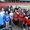 Boston: Members from UMass Boston and Salem State University came together on Tuesday afternoon for a ceremonial coin flip at Fenway Park to determine the home team in the two teams' Frozen Fenway contest on January 7th, 2014. David Le/Salem News