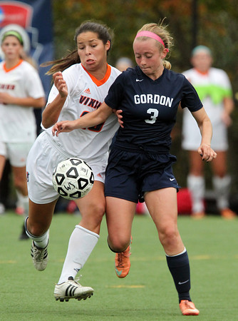 Salem: Salem State senior striker Sheena Regan (20) battles with Gordon sophomore midfielder Lauren Hayes (3) battle for a 50/50 ball. Behind a goal from sophomore Kelly Birchmore the Vikings upset the No. 24 ranked Fighting Scots 1-0 at Alumni Field on Thursday afternoon. David Le/Salem News