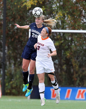 Salem: Gordon College freshman defense Sammi Morren (20) and Salem State University sophomore striker Kelly Birchmore (3) battle for a header on Thursday afternoon. Birchmore scored the game's lone goal as the Vikings upset the No. 24 ranked Fighting Scots. David Le/Salem News