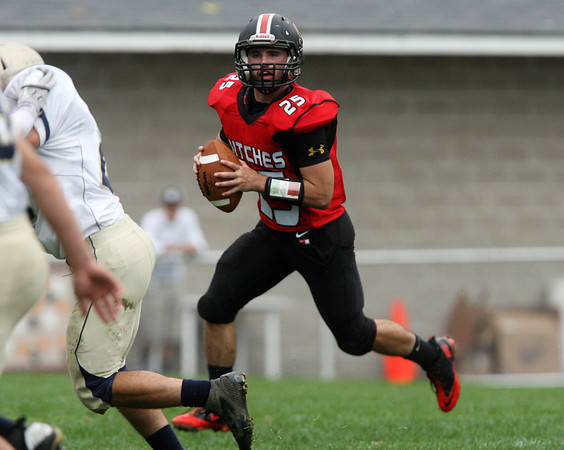 Beverly: Salem senior captain Austin Connolly (25) scrambles to his right and looks to pass against Winthrop on Saturday afternoon. David Le/Salem News