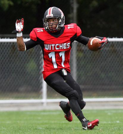 Beverly: Salem senior Shakir White (11) cuts back on a kick return against Winthrop on Saturday afternoon. David Le/Salem News