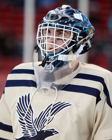 Boston: St. John's Prep goalie freshman goalie Zach Laramie glances up at the centerfield score board during warmups of the Eagles' Frozen Fenway game against Catholic Conference rival Malden Catholic on Tuesday afternoon. DAVID LE/Staff Photo