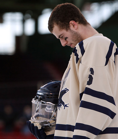 Boston: St. John's Prep senior defenseman Ean Mendeszoon bows his head during the singing of the National Anthem prior to the start of the Eagles' Frozen Fenway game against Catholic Conference rival Malden Catholic on Tuesday afternoon. DAVID LE/Staff Photo