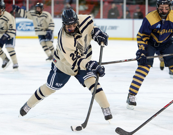 Boston: St. John's Prep sophomore forward Seth Murray (22) fires a slap shot on net during the Eagles' Frozen Fenway game against Catholic Conference rival Malden Catholic on Tuesday afternoon. DAVID LE/Staff Photo