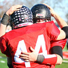 Marblehead: Marblehead junior running back Brooks Tyrrell (44) gets a hug from senior teammate Crandall Maxwell, right, after the Magicians 51-13 win over the Big Blue on Thanksgiving morning at Piper Field in Marblehead. David Le/Salem News