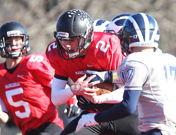 Marblehead: Marblehead senior quarterback Matt Millett (2) plows forward for a few extra yards during the Magicians 51-13 thumping of the Big Blue on Thanksgiving morning at Piper Field in Marblehead. David Le/Salem News