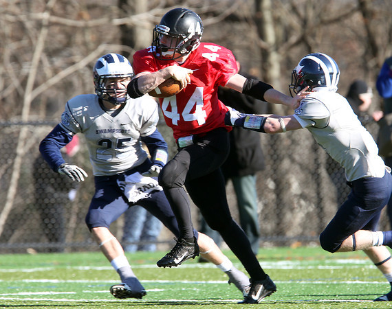 Marblehead: Marblehead junior running back Brooks Tyrrell (44) breaks away from Swampscott senior Cam Frary (25) and senior captain Ben Faulkner (4) for 77-yard touchdown run, Tyrrell's sixth of the game during the Magicians 51-13 thumping of the Big Blue on Thanksgiving morning at Piper Field in Marblehead. David Le/Salem News