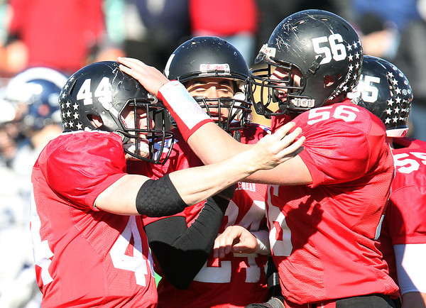 Marblehead: Marblehead junior running back Brooks Tyrrell (44) celebrates his 6th touchdown run of the game, a 77-yard score, with teammates David Bolognese (24) and Dan Marino (56), during the Magicians 51-13 thumping of the Big Blue on Thanksgiving morning at Piper Field in Marblehead. David Le/Salem News