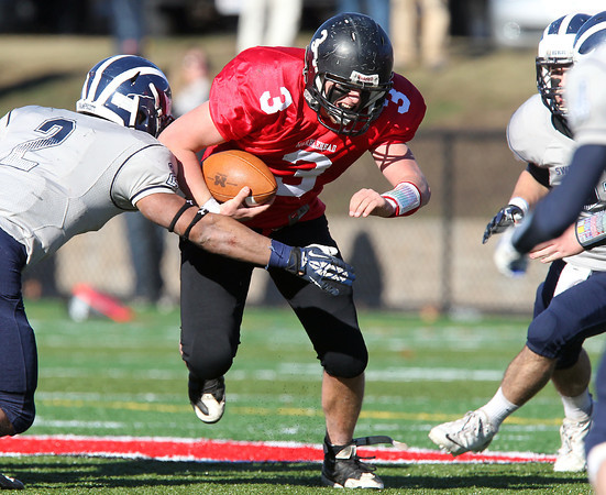Marblehead: Marblehead junior quarterback Spencer Craig (3) drives forward for a few more yards against Swampscott during the Magicians 51-13 thumping of the Big Blue on Thanksgiving morning at Piper Field in Marblehead. David Le/Salem News