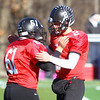 Marblehead: Marblehead senior quarterback Matt Millett (2) celebrates with senior classmate Michael Simmons (61) after the Millett took a knee to end the Magicians 51-13 thumping of the Big Blue on Thanksgiving morning at Piper Field in Marblehead. David Le/Salem News