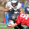 Marblehead: Swampscott senior running back Desmond Wilhelmsen (2) can't escape the tackle from Marblehead senior captain Liam Gillis (52), during the second half of the Magicians 51-13 thumping of the Big Blue on Thanksgiving morning at Piper Field in Marblehead. David Le/Salem News