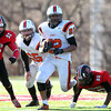 Salem: Beverly senior running back Isiah White (22) breaks away from Salem senior Josh McRae (50) and senior Jerry Canada (80) during the 115th meeting between the Witches and Panthers at the newly renovated Bertram Field in Salem on Thanksgiving morning. The Panthers behind three touchdowns by Isiah White took down the Witches 20-6. David Le/Salem News