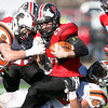 Salem: Salem senior captain Austin Connolly (25) gets brought down by Beverly seniors Joey Kozlowski (25) and  captain Sean Winston (53) during the 115th meeting between the Witches and Panthers at the newly renovated Bertram Field in Salem on Thanksgiving morning. The Panthers behind three touchdowns by senior running back Isiah White took down the Witches 20-6. David Le/Salem News
