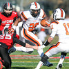 Salem: Beverly sophomore running back Matt Madden (28) manages to elude Salem senior captain Austin Connolly (25) during the 115th meeting between the Witches and Panthers at the newly renovated Bertram Field in Salem on Thanksgiving morning. The Panthers behind three touchdowns by senior running back Isiah White took down the Witches 20-6. David Le/Salem News