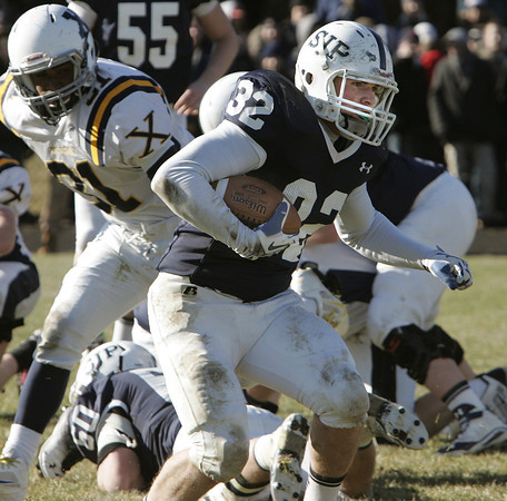 Danvers:<br /> St. Johns Prep's Jack Lambert runs the ball through an opening during the Xaverian at St. John's Prep Thanksgiving football game.<br />  Photo by Ken Yuszkus / The Salem News, Thursday, November 28, 2013.