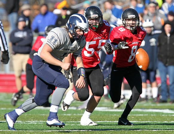 Marblehead: Swampscott senior quarterback Brendan McDonald (11) chases down a fumbled snap with Marblehead seniors Thomas Koopman (55) and Dean Fader (8) hot on his heels during the Magicians 51-13 thumping of the Big Blue on Thanksgiving morning at Piper Field in Marblehead. David Le/Salem News