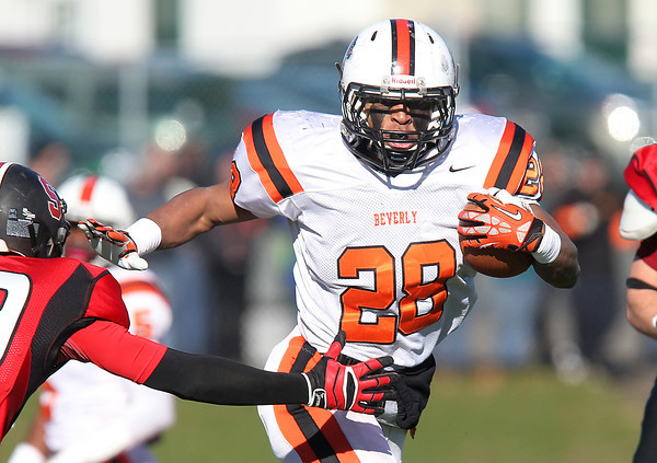 Salem: Beverly sophomore running back Matt Madden (28) throws a stiff arm during the first half of play in the 115th meeting between the Witches and Panthers at the newly renovated Bertram Field in Salem on Thanksgiving morning. The Panthers behind three touchdowns by senior running back Isiah White took down the Witches 20-6. David Le/Salem News
