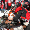 Salem: Salem senior captain Austin Connolly (25) drags down Beverly sophomore Peter Mulumba (7) for a loss of yards during the 115th meeting between the Witches and Panthers at the newly renovated Bertram Field in Salem on Thanksgiving morning. The Panthers behind three touchdowns by senior running back Isiah White took down the Witches 20-6. David Le/Salem News