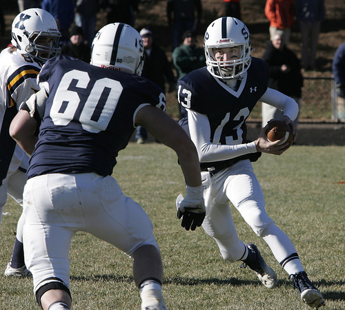 Danvers:<br /> St. Johns Prep's Michael Geaslen runs the ball to the side during the Xaverian at St. John's Prep Thanksgiving football game.<br />  Photo by Ken Yuszkus / The Salem News, Thursday, November 28, 2013.