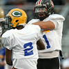 Salem's Christian Costa (41) celebrates a South turnover with Lynn Classical's Jordan Brown (2). DAVID LE/Staff photo. 6/26/14.