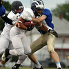 Swampscott running back Desmond Wilhelmsen (South) powers his way towards the goal line against the North during the 53rd Agganis football game. DAVID LE/Staff photo. 6/26/14.