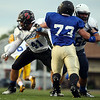 South linemen Christian Costa (Salem), left, and Joseph Molica (Peabody), block North defensive lineman Tyler Kaufman (Bishop Fenwick). DAVID LE/Staff photo. 6/26/14.